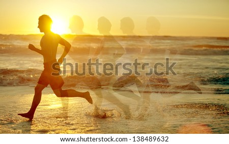 Man running on the beach - motion blurred - stock photo