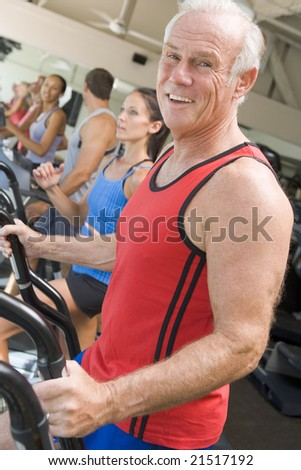 Man Running On Treadmill At Gym - stock photo