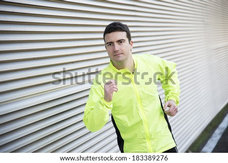 man running outdoor in the road - stock photo