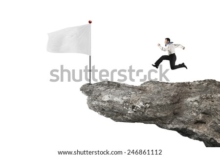 man running to blank flag on cliff with white background - stock photo