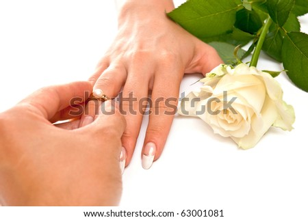 Man's and woman's hands with golden ring. Isolated - stock photo