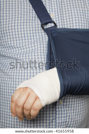 Man's arm in cast and sling