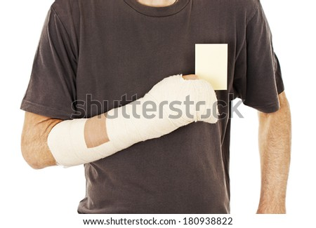 Man's arm in cast holding a blank card. Isolated on white background  - stock photo