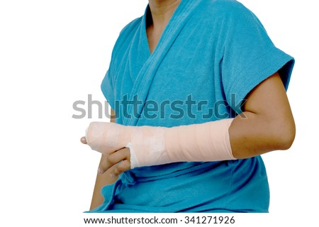 man's arm in cast with bandage dressed blue vest