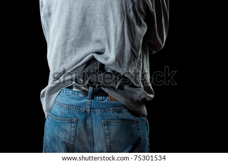 Man`s back with gun tucked in pants. Isolated on white background. - stock photo