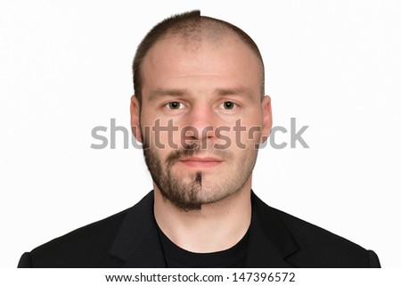 Man's Face. The half of his face is with Beard and with hair and another half without Beard and without hair. Isolated background. Horizontal photo. The man is looking directly into the camera.