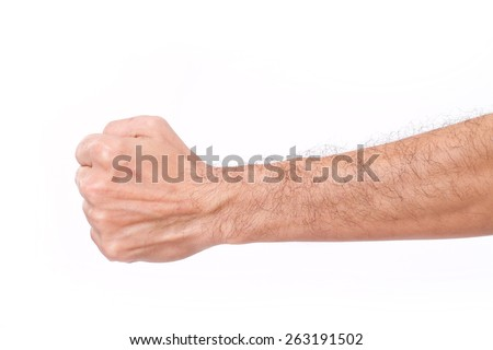 man's fist with hairy arm - stock photo