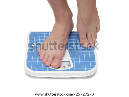 Man's foot, which  weighed on floor scale. Isolated - stock photo