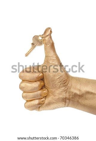 Man's golden hand with a key shows sign OK over white background - stock photo