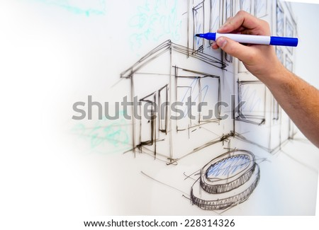 Man's hand creating a free drawing of a mansion in perspective on a whiteboard as rough sketch - stock photo
