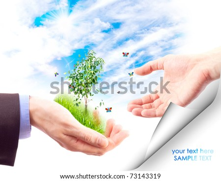 Man's hand gives  the other hand, a piece of nature.  Collage. - stock photo