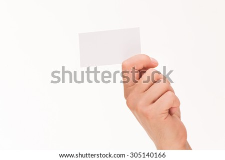 Man's hand holding a card over white background. A blank credit card is kept by two man's right hand. Use can type any text on this card.  - stock photo