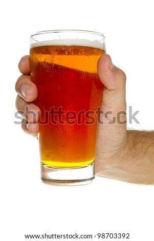 Man's hand holding a cold beer.