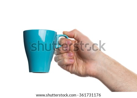 Man's hand holding a cup