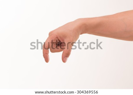 Man's hand holding a thing isolated on white background. Man's hand picking something smelly from the gabbage bin. - stock photo