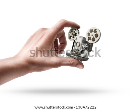 Man's hand holding cinema projector isolated on white background