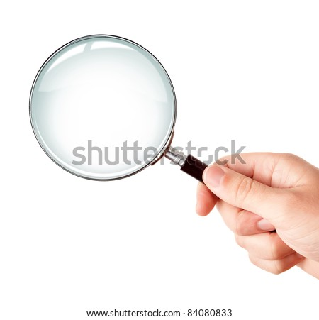 Man's hand, holding classic styled magnifying glass, closeup isolated on white background, copy space for your image or text - stock photo