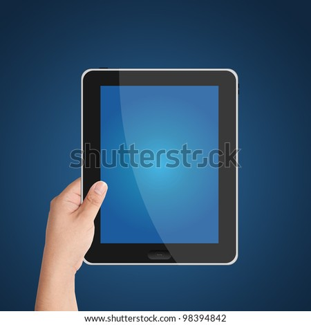 Man's hand holding digital tablet PC with blue screen. Isolated on blue background - stock photo