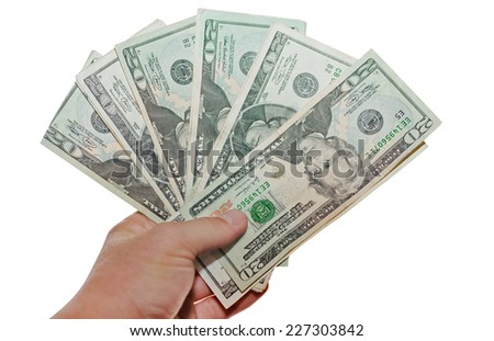 Man's hand holding 20 dollar bank notes. Isolated on a white background with clipping path. - stock photo