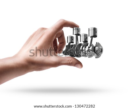 Man's hand holding Engine pistons isolated on white background - stock photo
