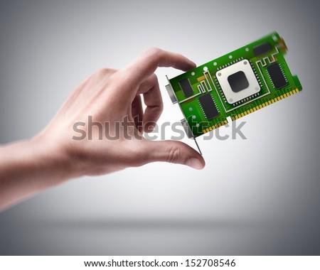 Man's hand holding graphic card GPU - stock photo