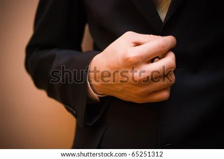 Man's hand holding his jacket - stock photo