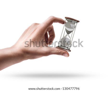 Man's hand holding hourglass isolated on white background - stock photo