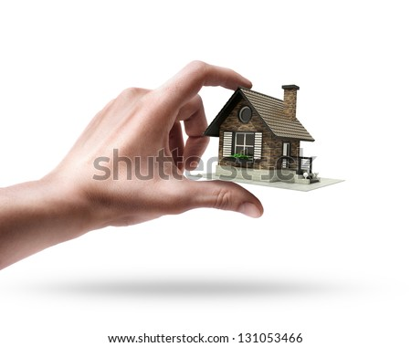 Man's hand holding house isolated on white background - stock photo