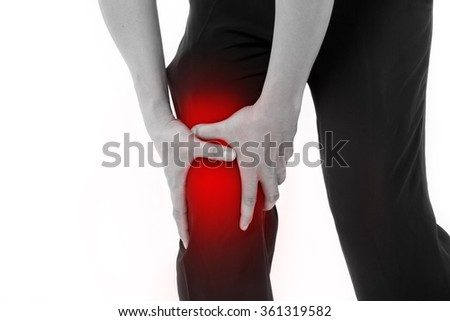 man's hand holding knee joint pain - stock photo