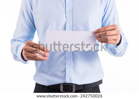 Man's hand holding the fly air tickets over white background - closeup shot of business card  - stock photo