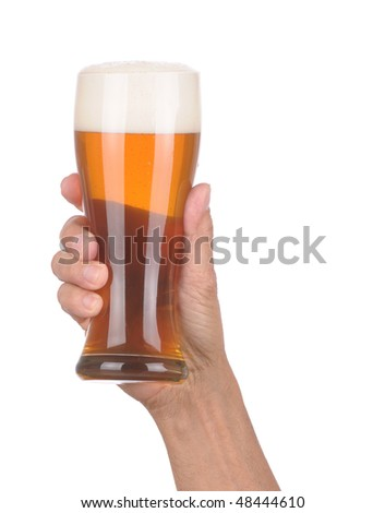 Man's Hand Holding up a Glass of Foamy Beer over a white background - stock photo