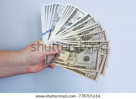man's hand keeps money dollars one hundred