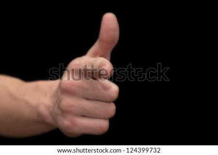 man's hand on a black background - stock photo