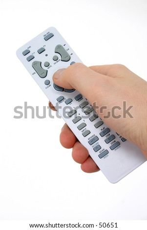 Man's hand on a remote control.