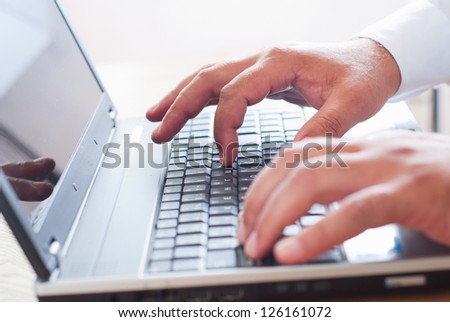 man's hand on the keyboard - stock photo