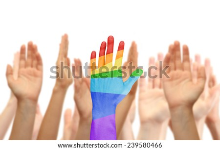 Man's hand painted as the rainbow flag on other hands background isolated on white - stock photo