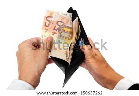 man's hand pulling cash from the wallet - stock photo