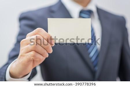 Man's hand showing business card - closeup sho - stock photo