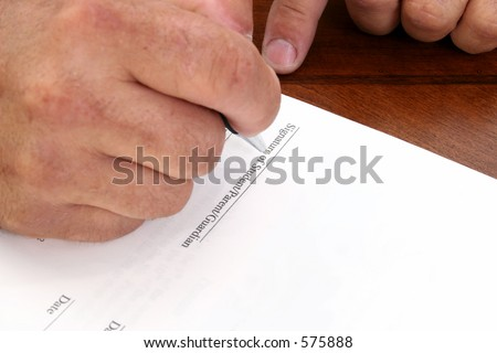 "Man's hand signing contract.  Line reads ""Signature of Student/Parent/Guardian""."