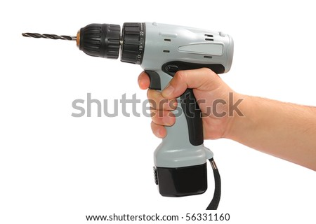 Man's hand with a drill - stock photo
