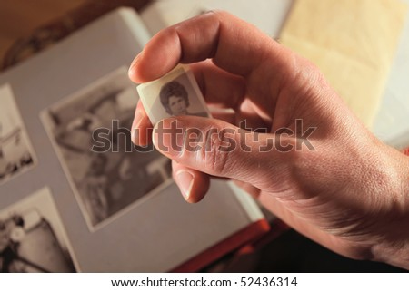 Man's hand with an old photo,focus on a hand - stock photo