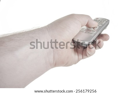 Man's hand with remote control, push the button - stock photo