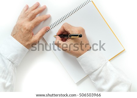 man's hand writing with a fountain pen. isolated