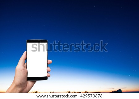 man's hands holding smart phone with blank copy space screen for your text message or information content blue sky sun rise background - stock photo