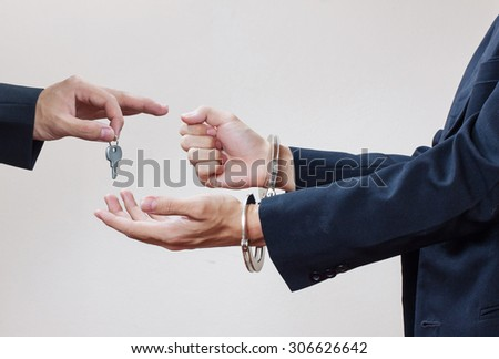 Man's hands in handcuffs - stock photo