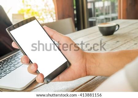 Man's hands using smart phone. - stock photo