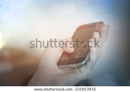 Man's hands using smart phone in interior