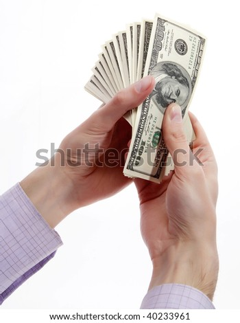 Man's hands with dollars