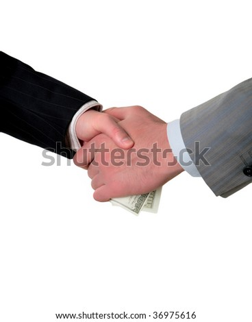 man's handshake and the transfer of money, hands closeup - stock photo