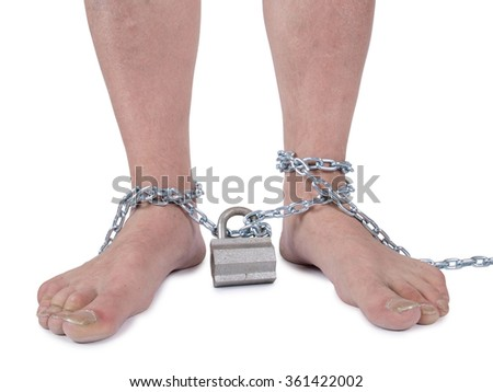 Man's legs and a metal chain        - stock photo